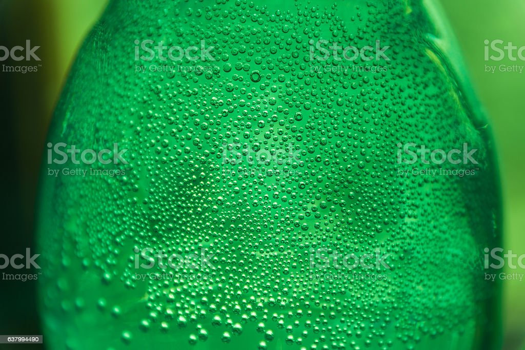 Oxygen bubbles in the bottle with water or drink. stock photo