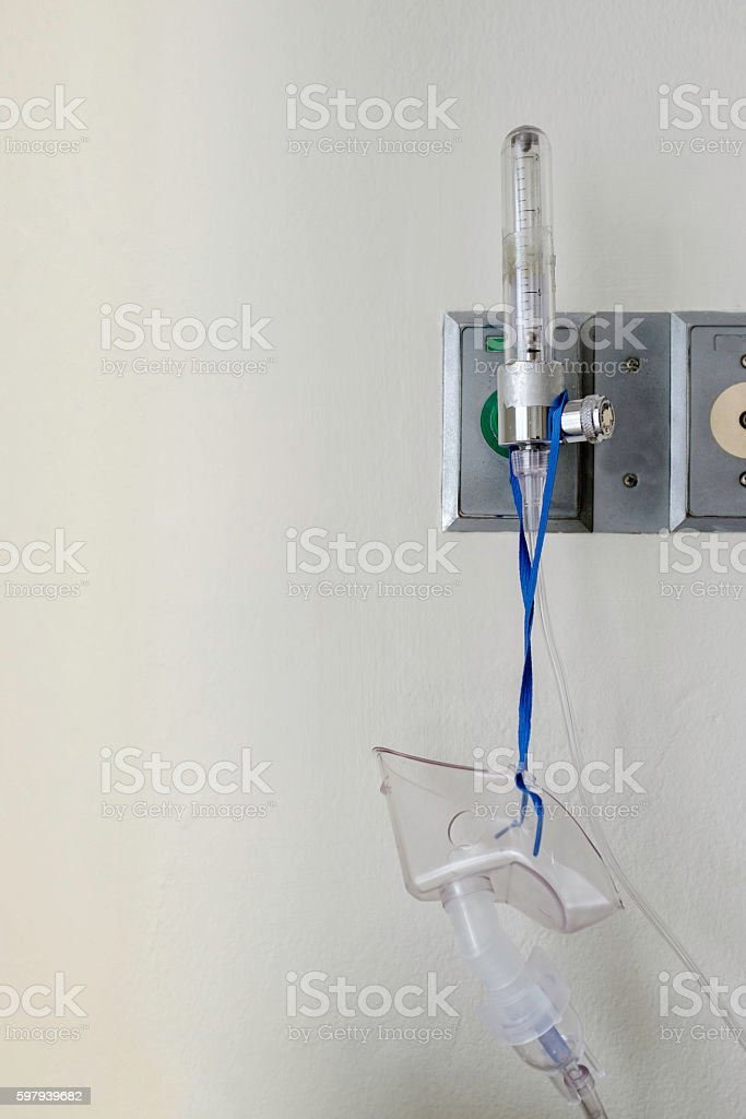 oxygen mask with pressure tube hang on wall stock photo