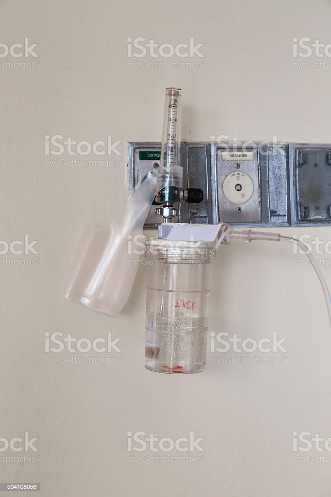 Oxygen piping and regulator with flow meter stock photo