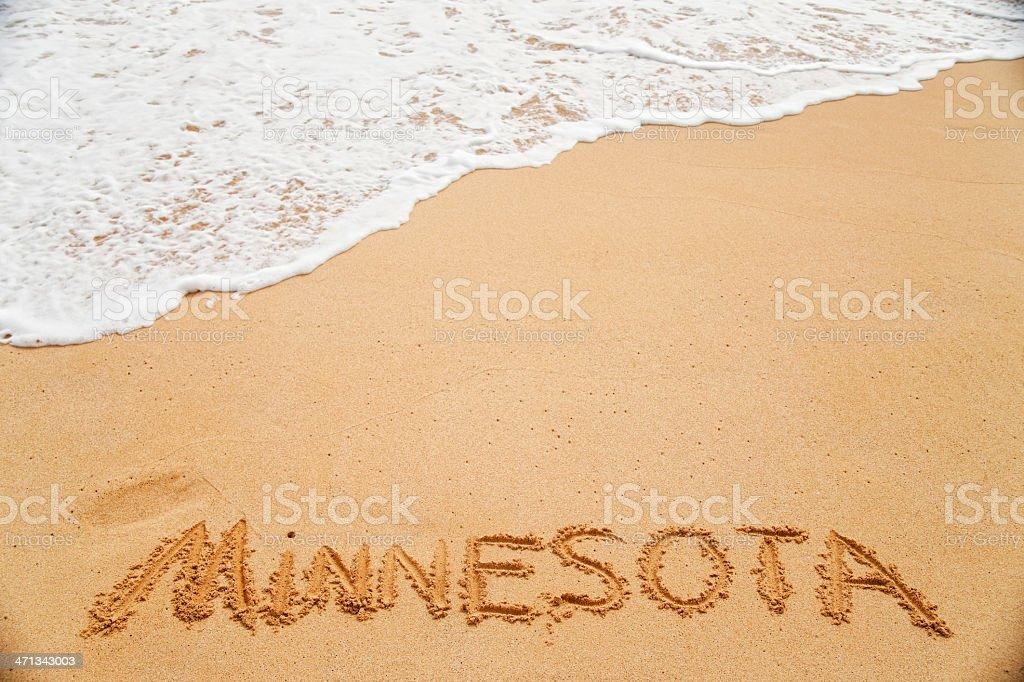 Oxymoron depicting 'Minnesota' written in beach sand. stock photo