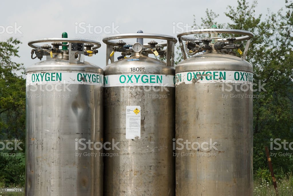 Oygen Cylinder Tanks in a Row Outdoors stock photo
