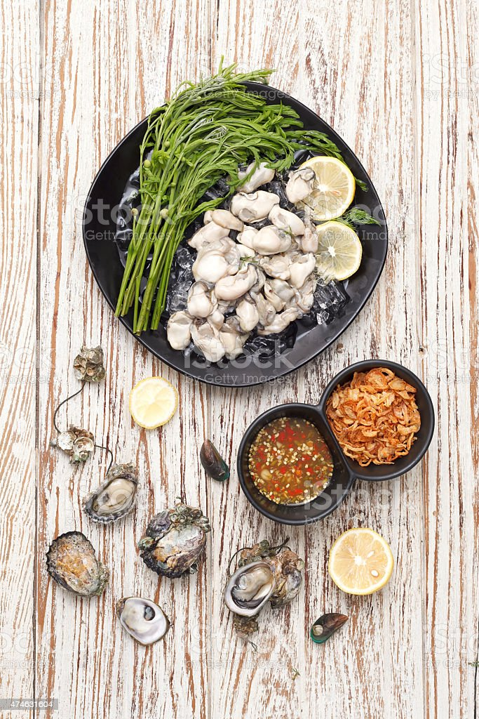 Oyster seafood lemon fresh asia  fried shallots sauce stock photo