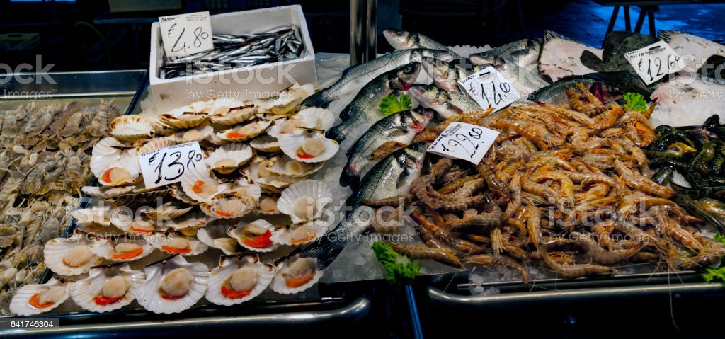 Oysters and shrimps at Fish Market in Italy stock photo