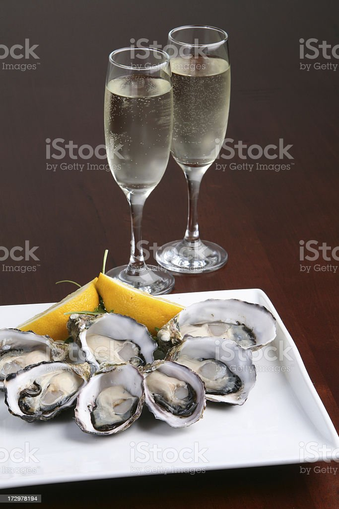 Oysters on a plate with champagne stock photo