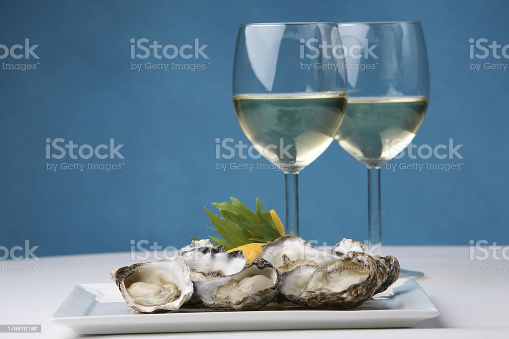 Oysters on blue stock photo