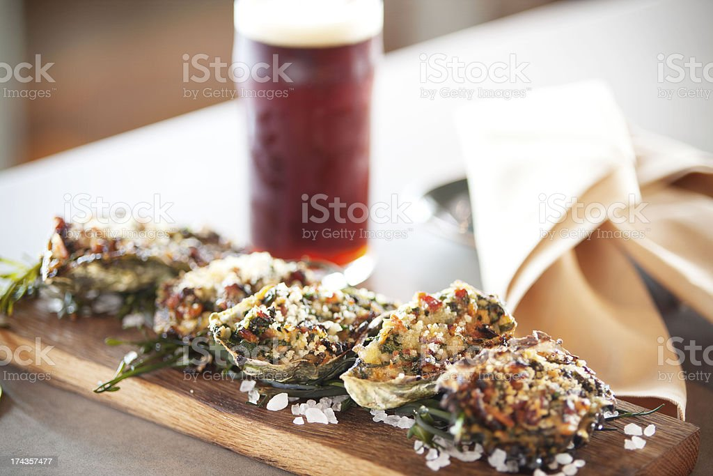 Oysters Rockafeller with Craft Beer royalty-free stock photo