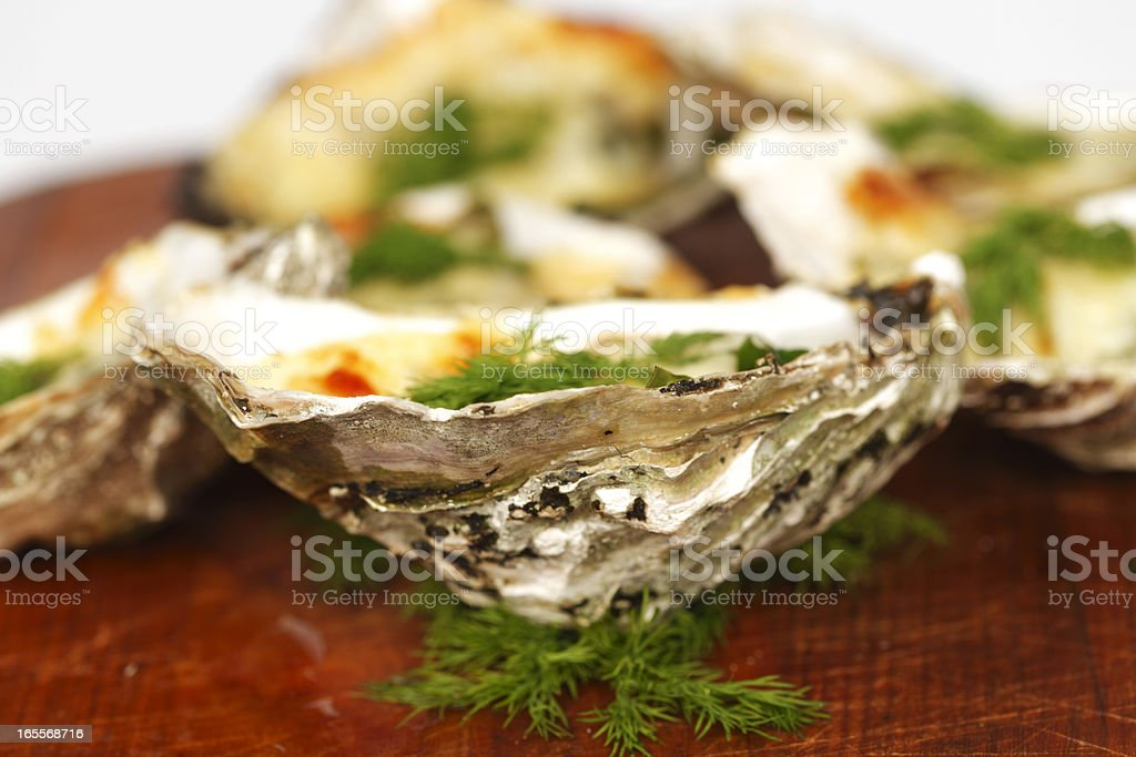 Oysters under cheese and dill stock photo