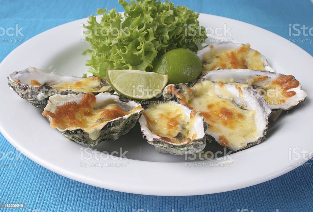 Oysters with cheese mornay stock photo