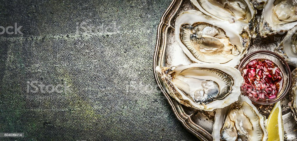 Oysters with lemon and sauce , top view, place for text stock photo