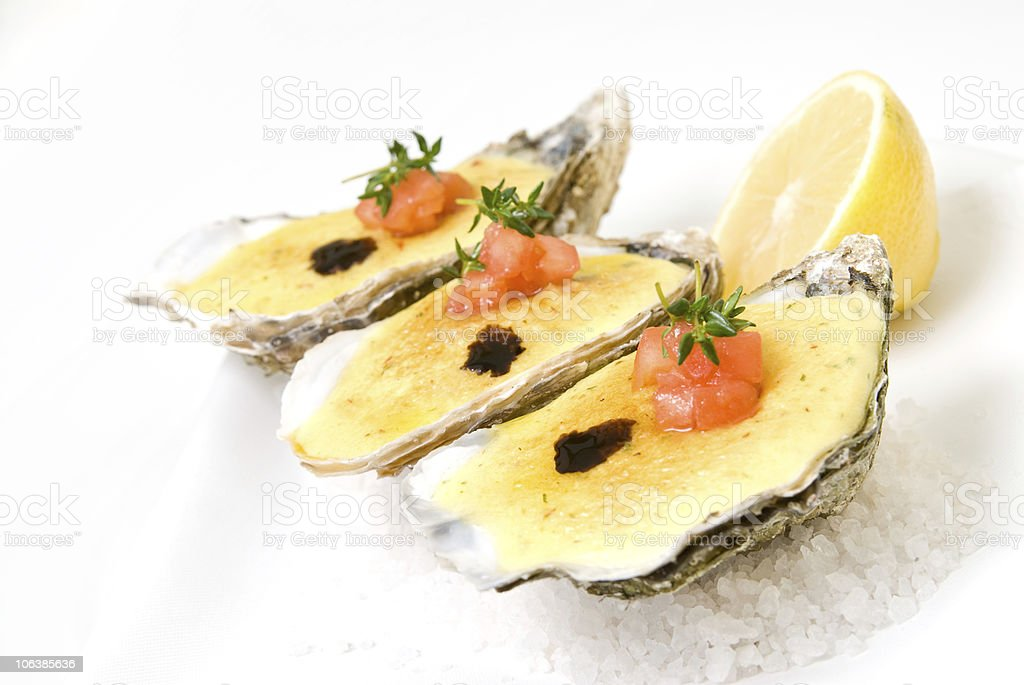 oysters with sauce and lemon on plate royalty-free stock photo