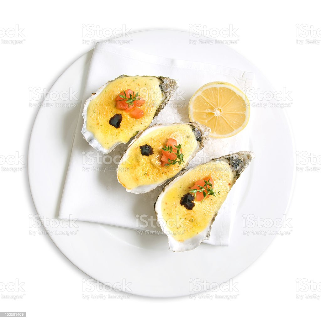 oysters with sauce and lemon on white royalty-free stock photo