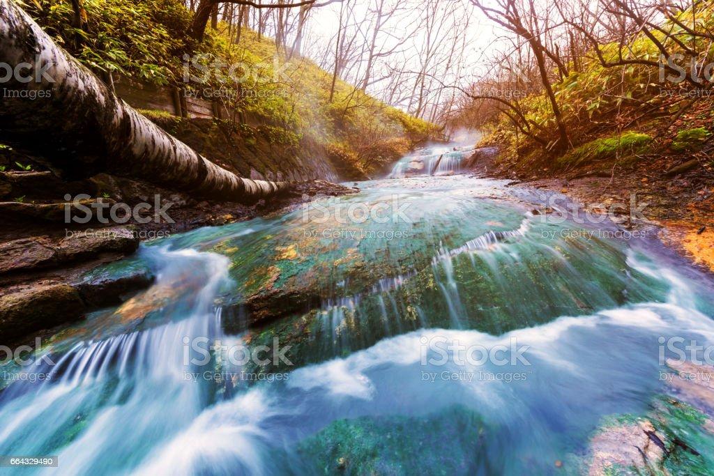 Oyunumagawa Hot spring waterfall with sunset light near Jigokudani hell valley, Noboribetsu stock photo