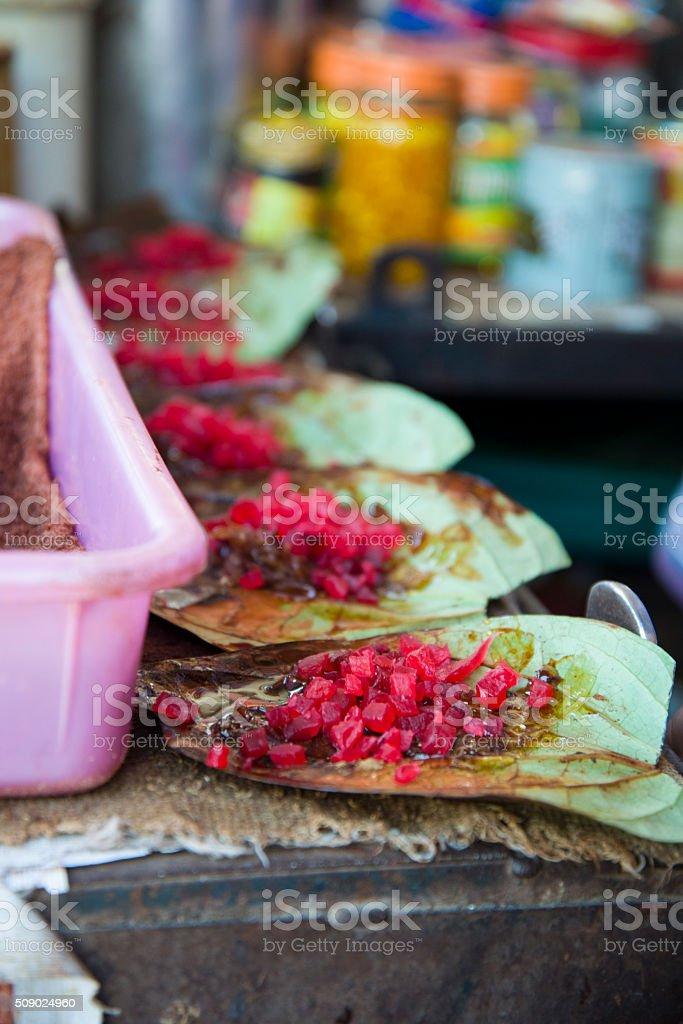 Paan Being Prepared At A Street Market in India stock photo
