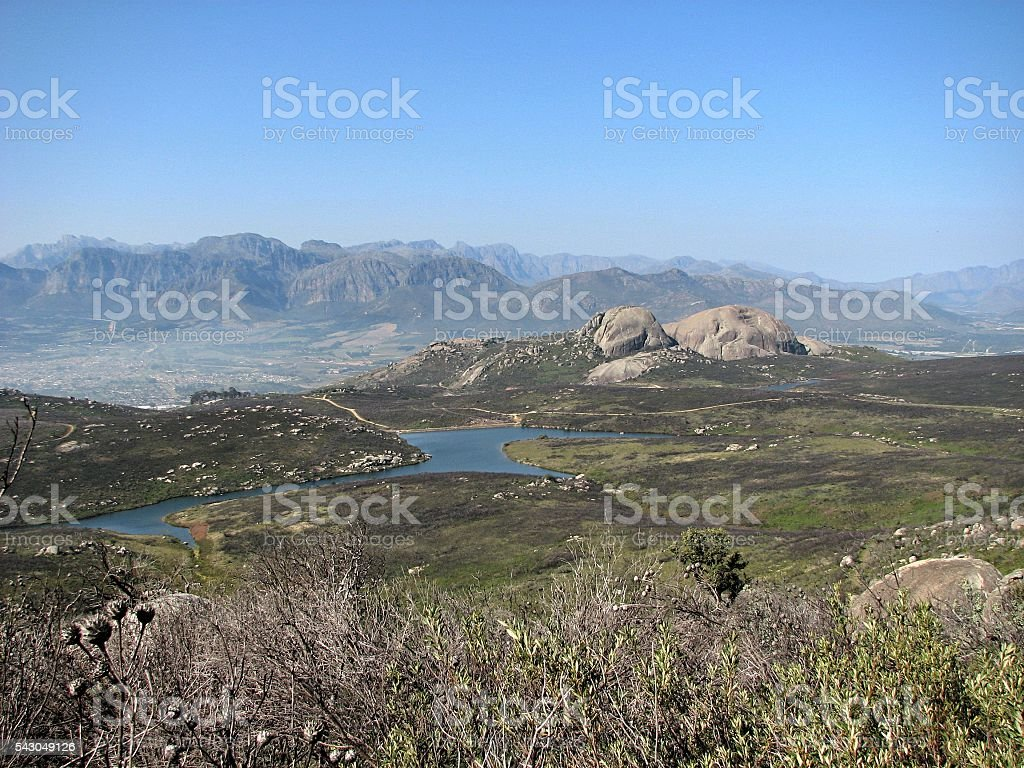 Paarl Rock panoramic over nature reserve and mountain range stock photo