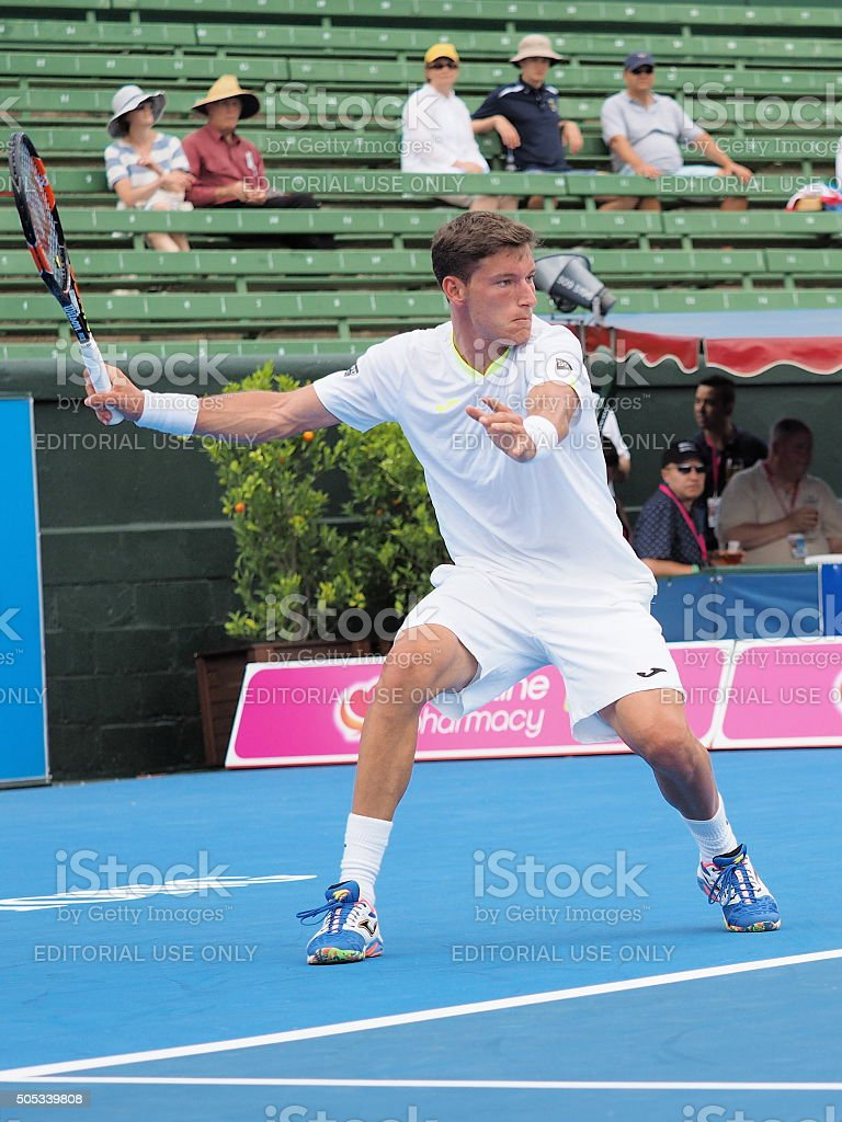 Pablo Carreno Busta winds up for a forehand stock photo