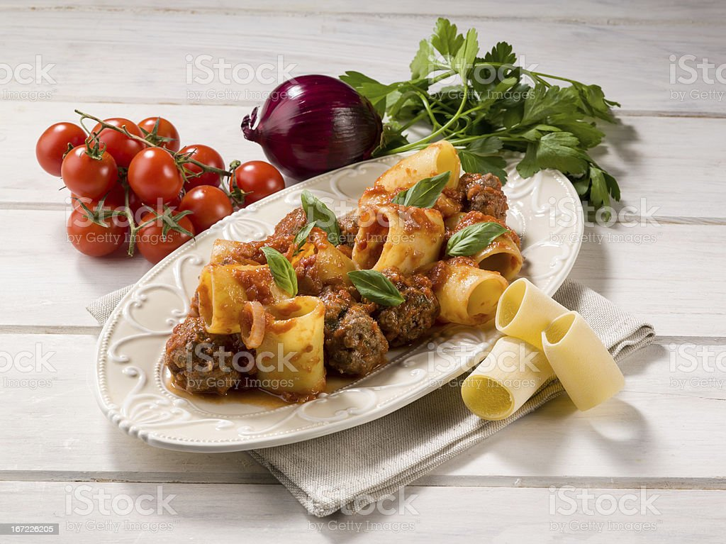 paccheri pasta with meatballs royalty-free stock photo
