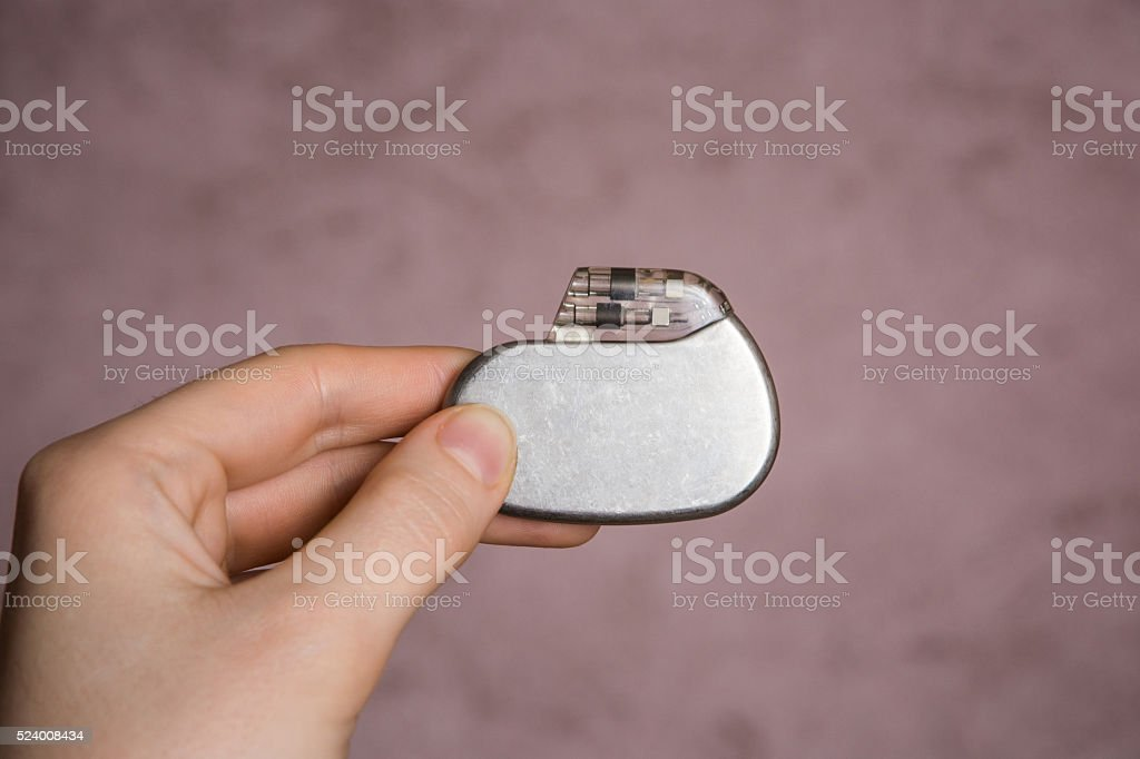 Pacemaker in his hand stock photo