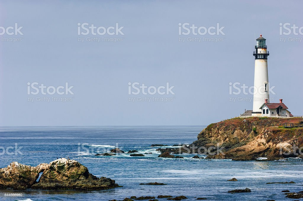 Pacific Coast Lighthouse and Rocky Shore stock photo