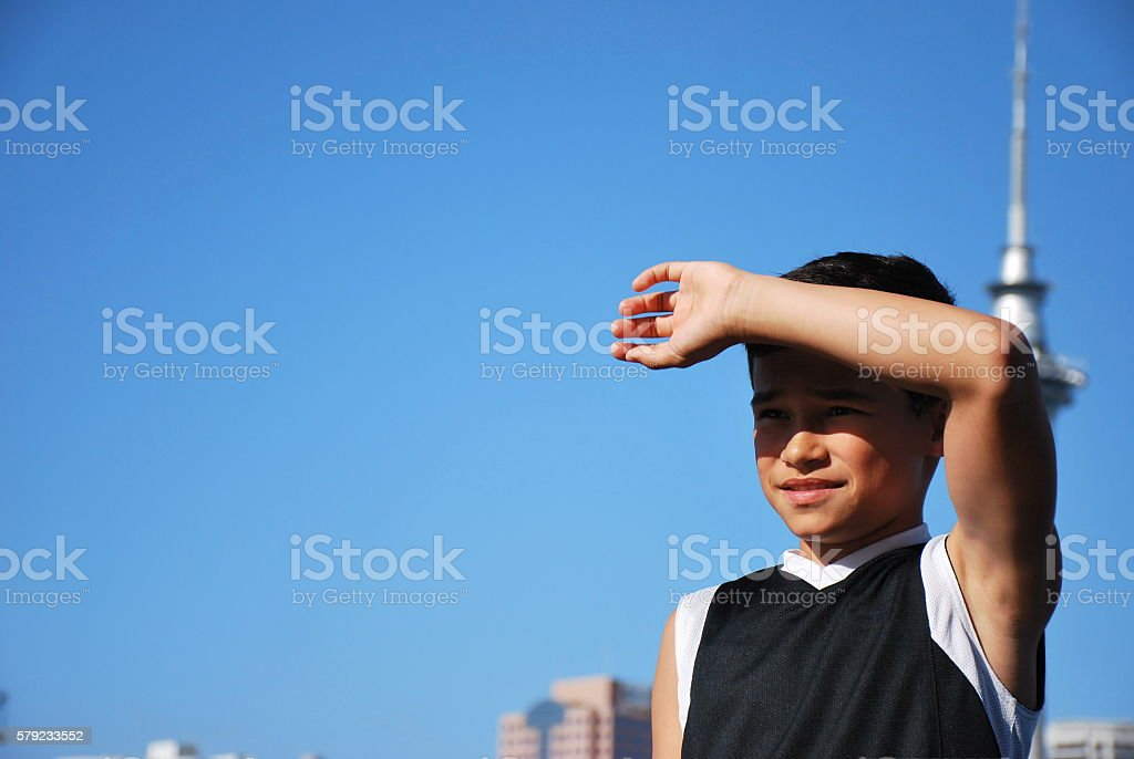 Pacific Island Boy Shading Sun out of Eyes stock photo