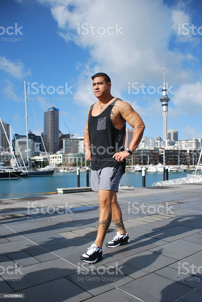 Pacific Island Man with Auckland Skyline, New Zealand stock photo