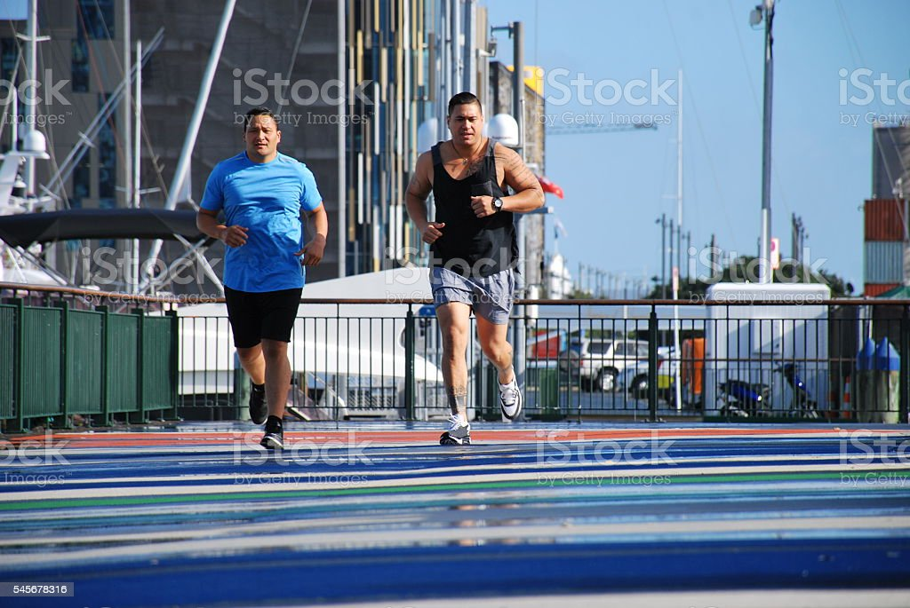 Pacific Island Men Jogging stock photo