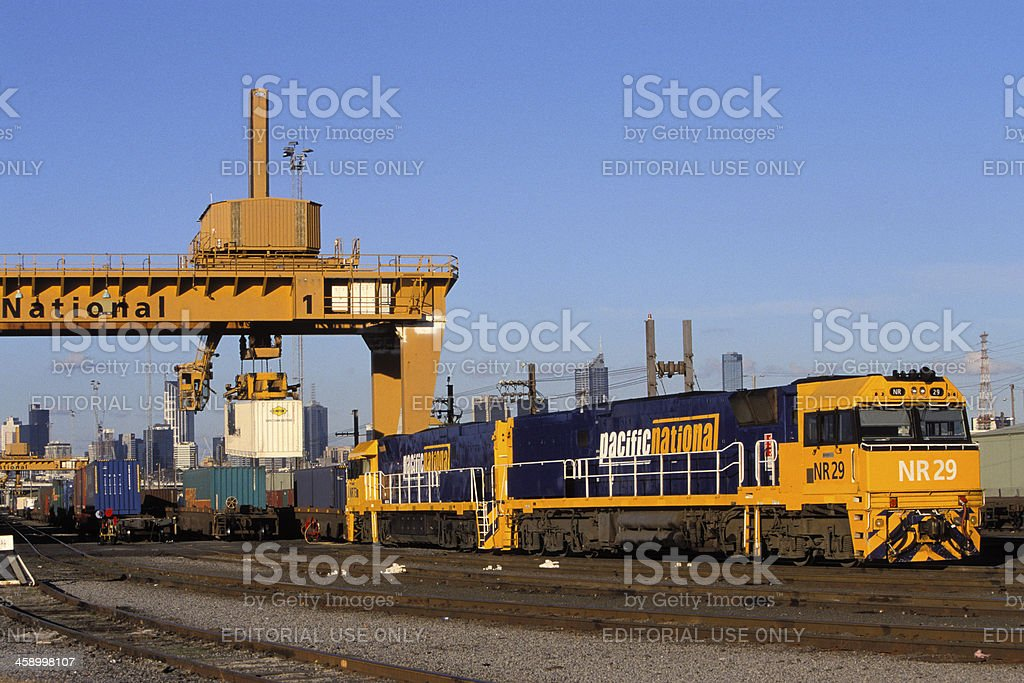 Pacific National freight train loading at city terminal stock photo