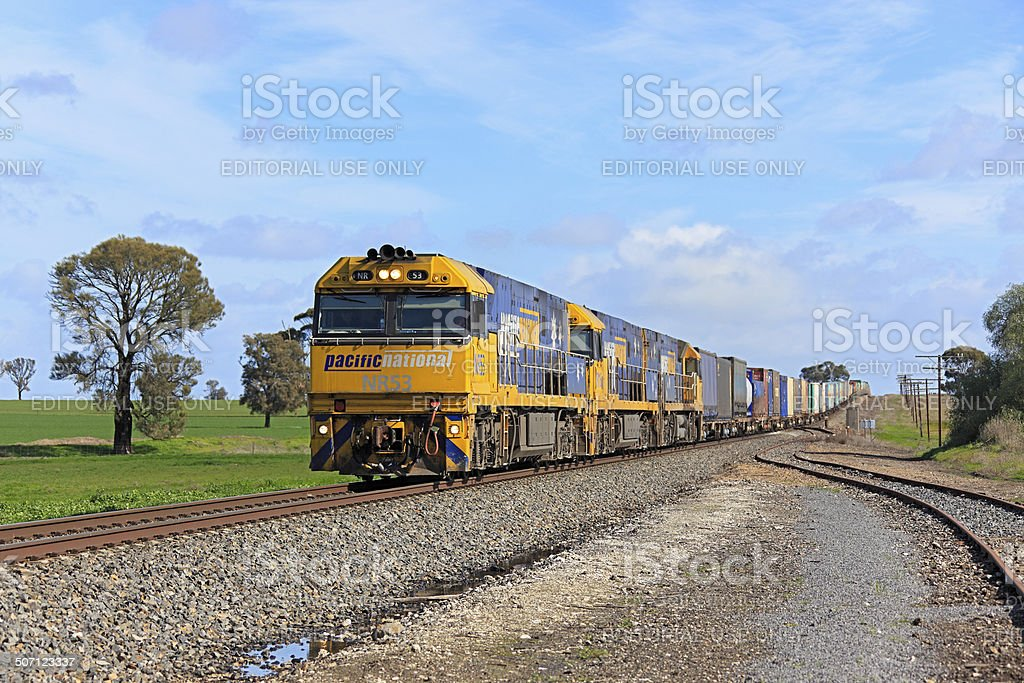 Pacific National intermodal freight train in countryside stock photo