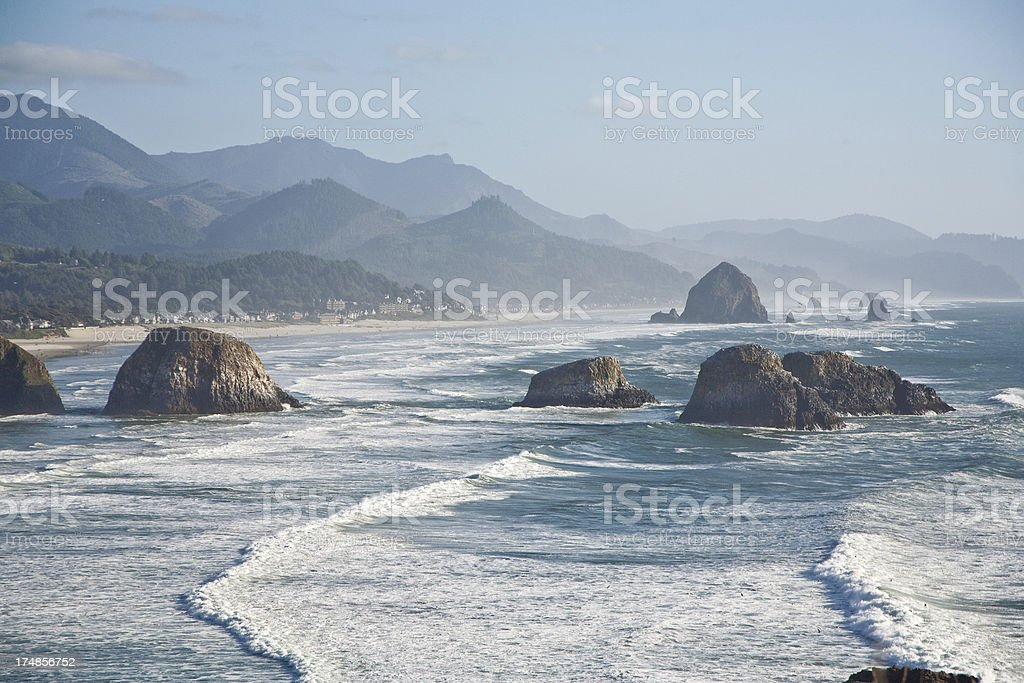 Pacific Northwest Coast Line Rocky Beach and Mountains royalty-free stock photo