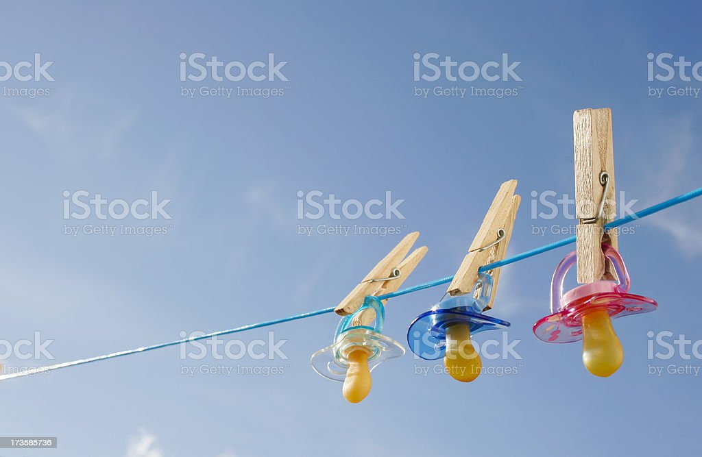 Pacifiers in clothes line stock photo