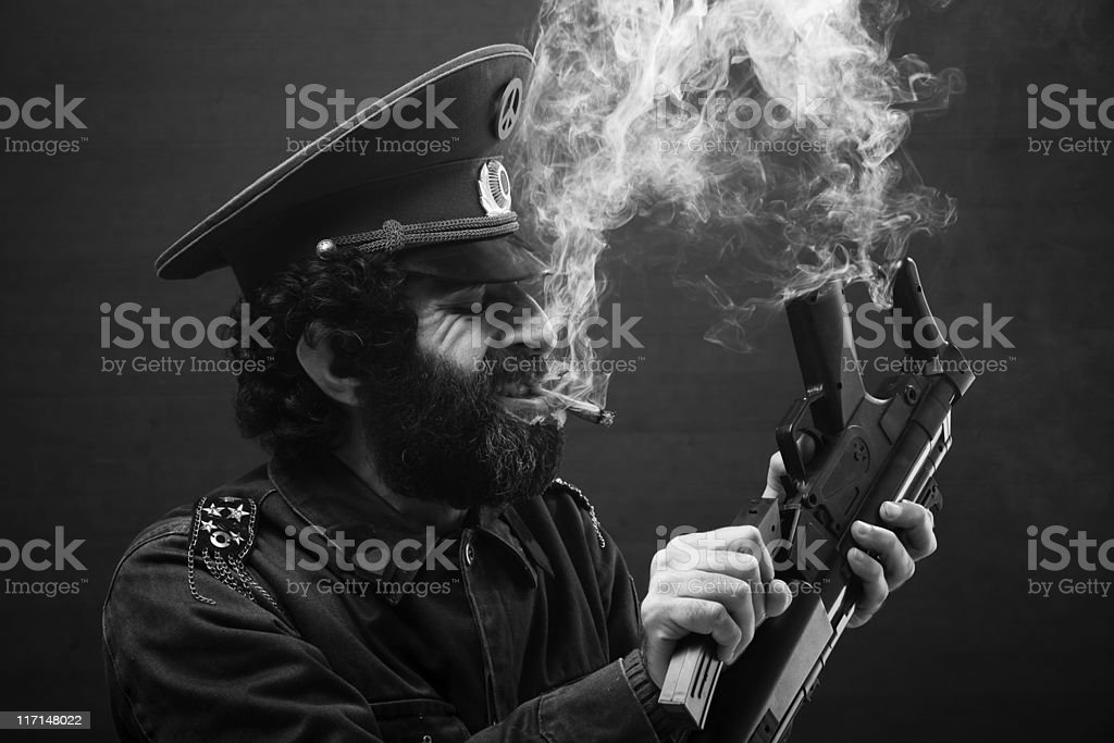 Pacifist general in military officier uniform breaking his weapon stock photo