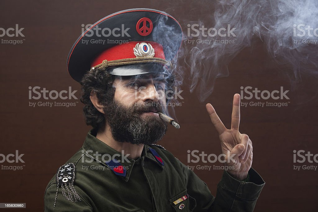 Pacifist general in military officier uniform making peace sign stock photo