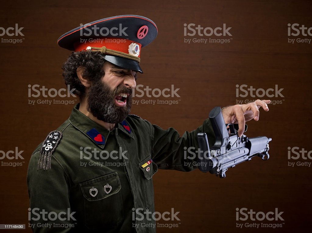 Pacifist military general leaving his weapon for peace stock photo