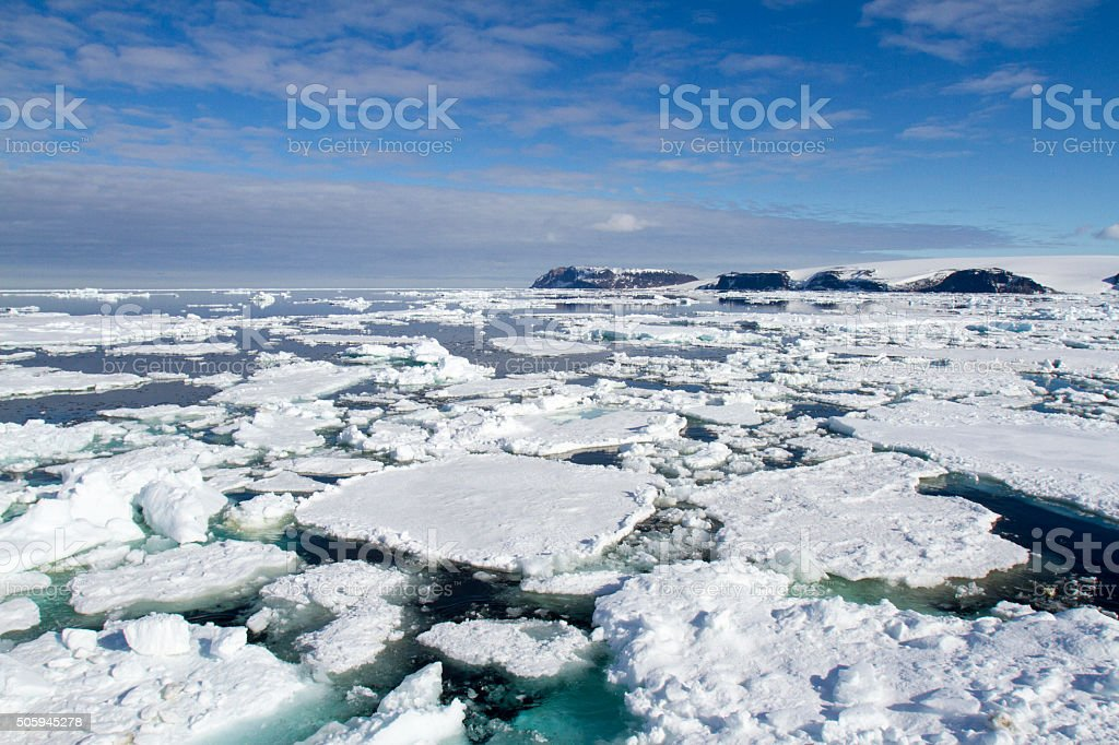 Pack ice in Antarctica on sunny day stock photo