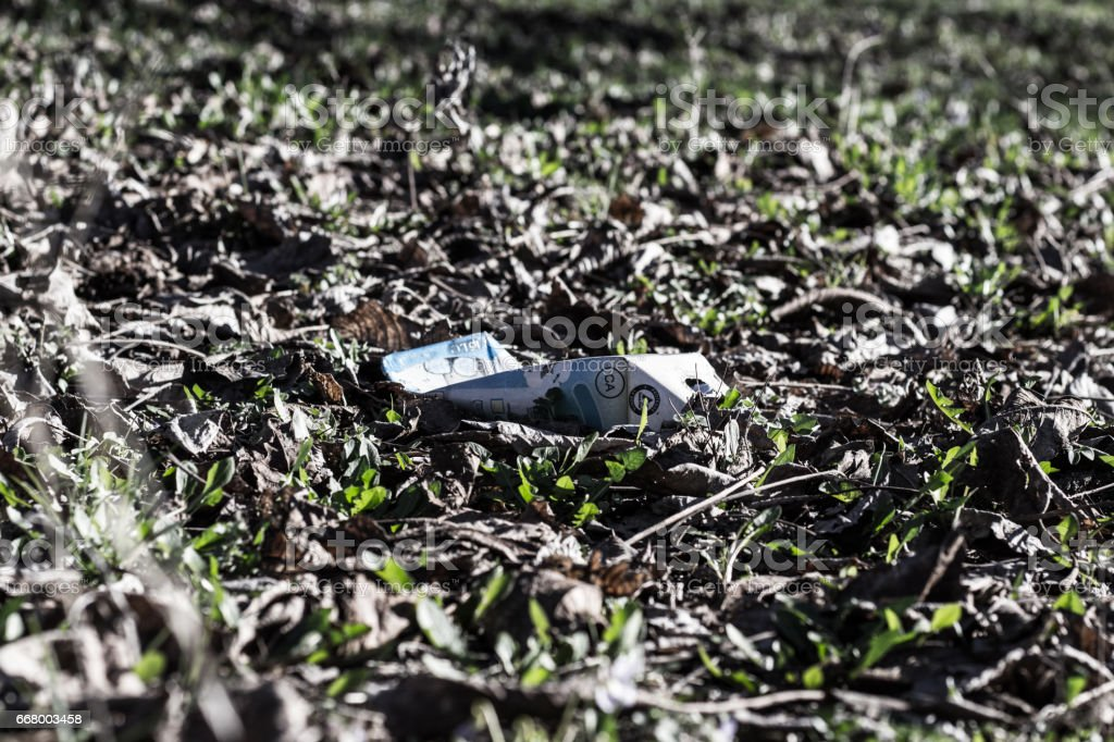 Pack Of Cigarettes on the Ground stock photo