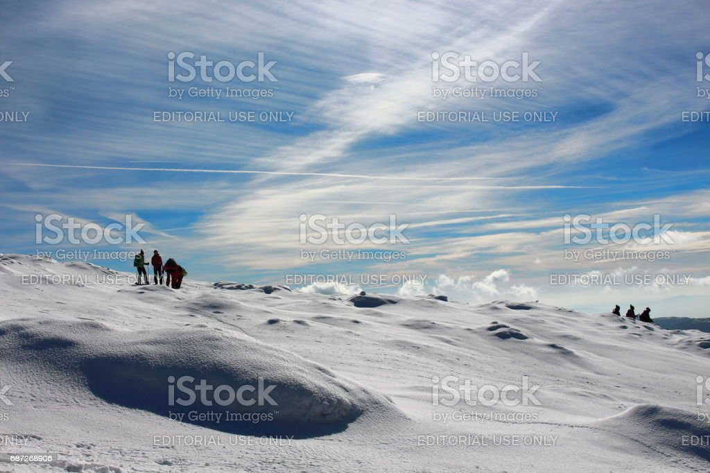 Spain, 29th of January, 2017. A pack of hikers walking down from...