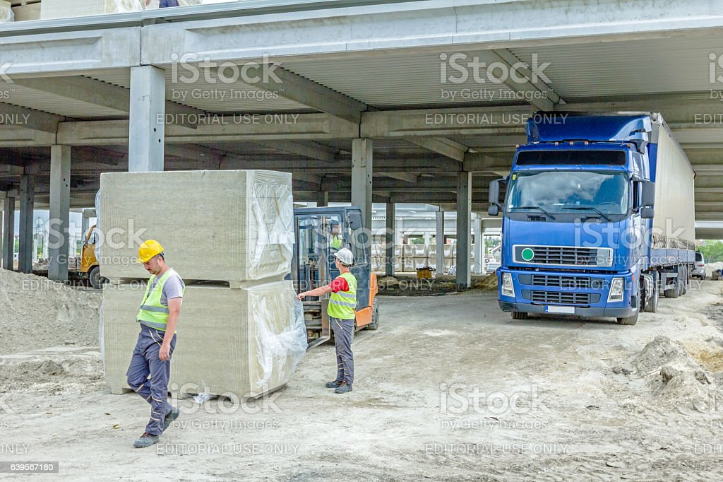 Package of glass wool for unfinished hall at building site. stock photo