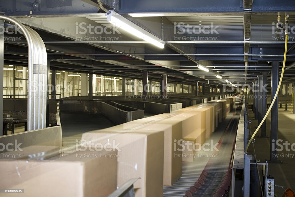 Packages being distributed on conveyor belt stock photo