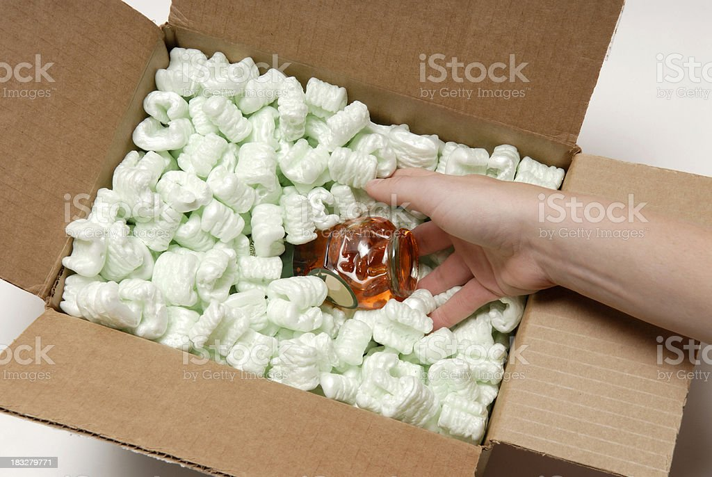 Packaging a fragile item royalty-free stock photo