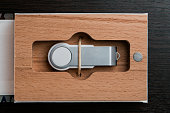 Packaging for USB drives. Handmade box. Wooden boxes on dark
