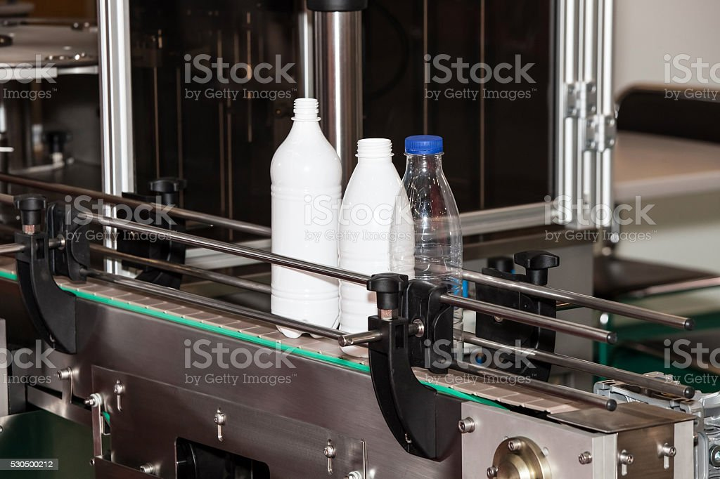Packaging milk bottles line stock photo
