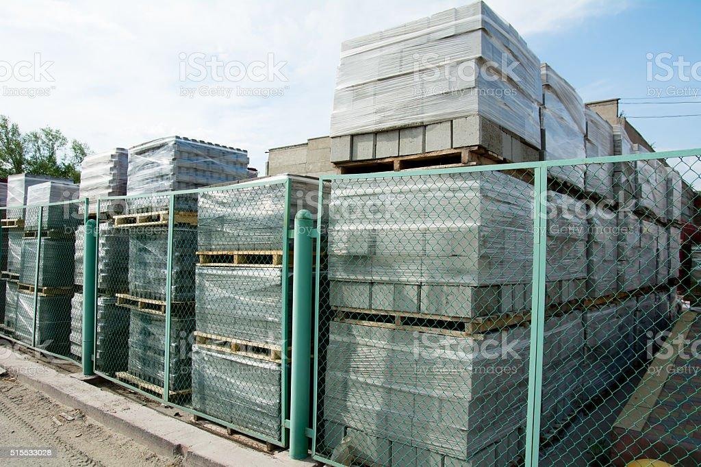 Packed cinder blocks outdoors in racks. stock photo