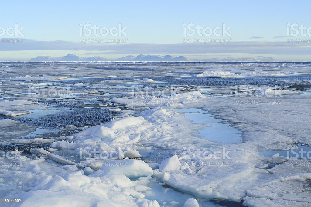 Packed ice tundra melts in the sun stock photo