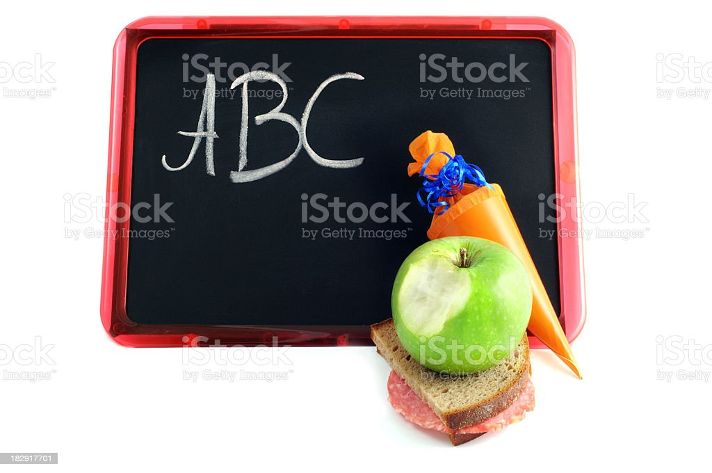 packed lunch Conical bag of sweets with letters on blackboard stock photo