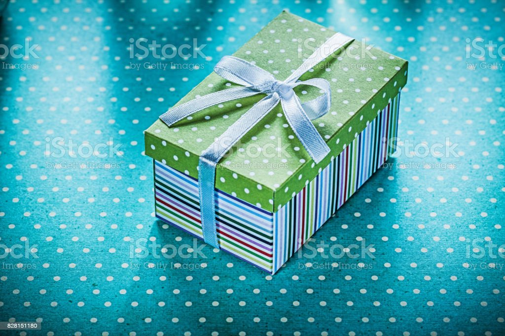 Packed present on blue polka-dot tablecloth holidays concept.
