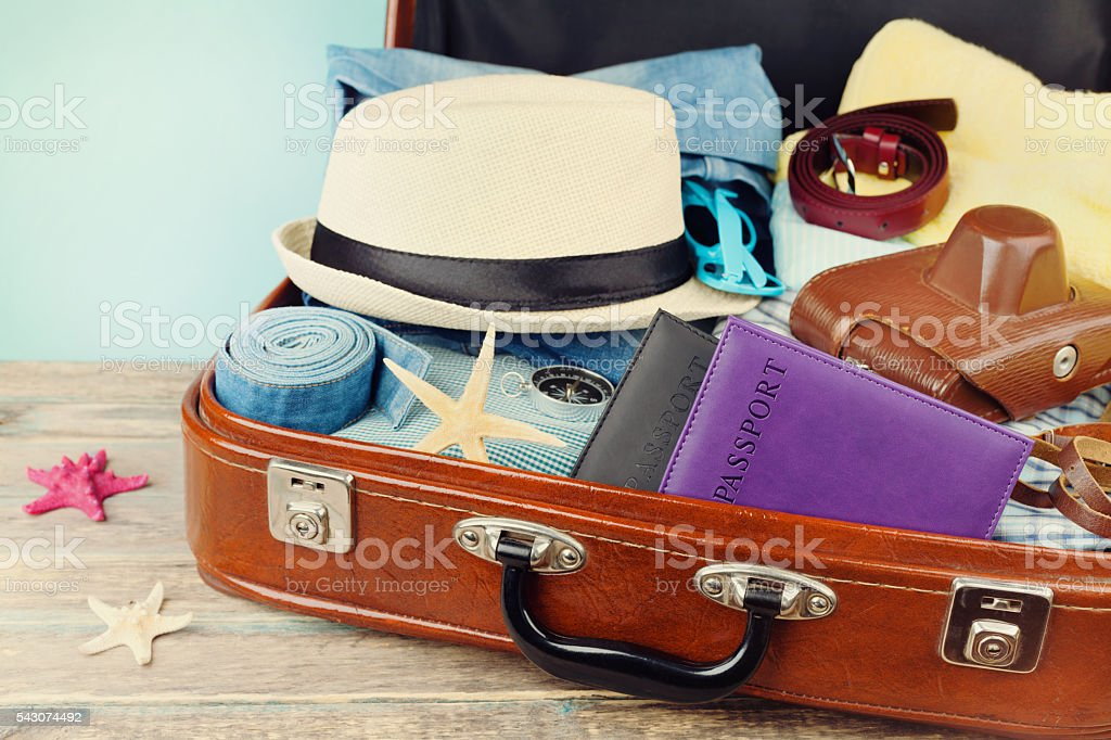 Packed vintage suitcase for summer holidays, vacation, travel and trip stock photo