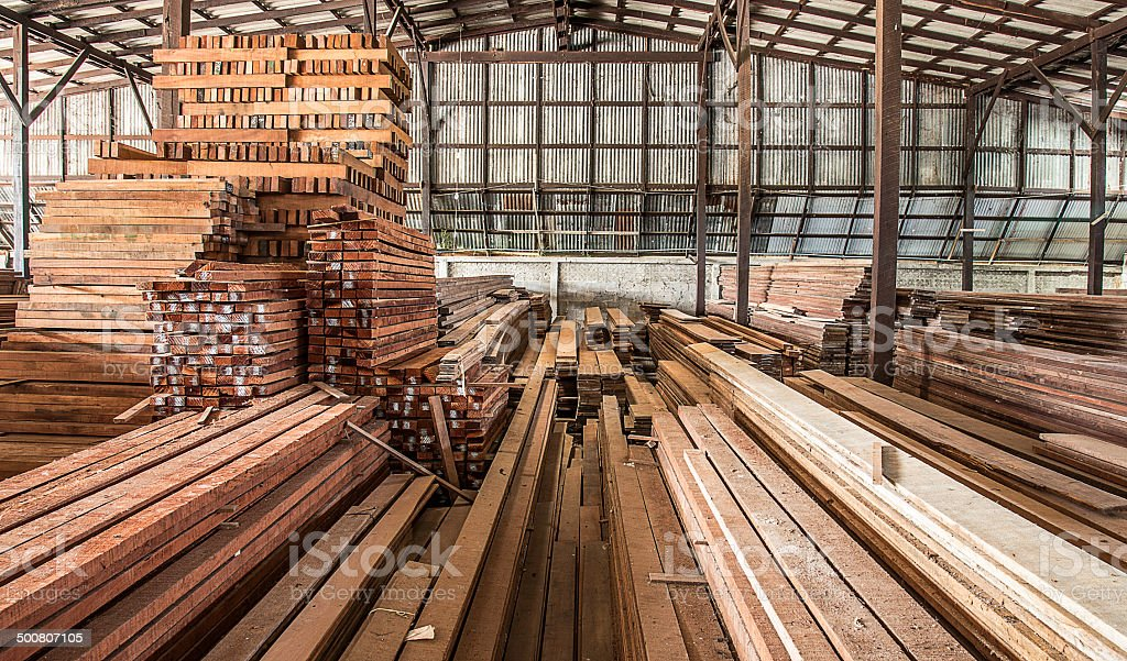 packed warehouse with wood ready for construction stock photo