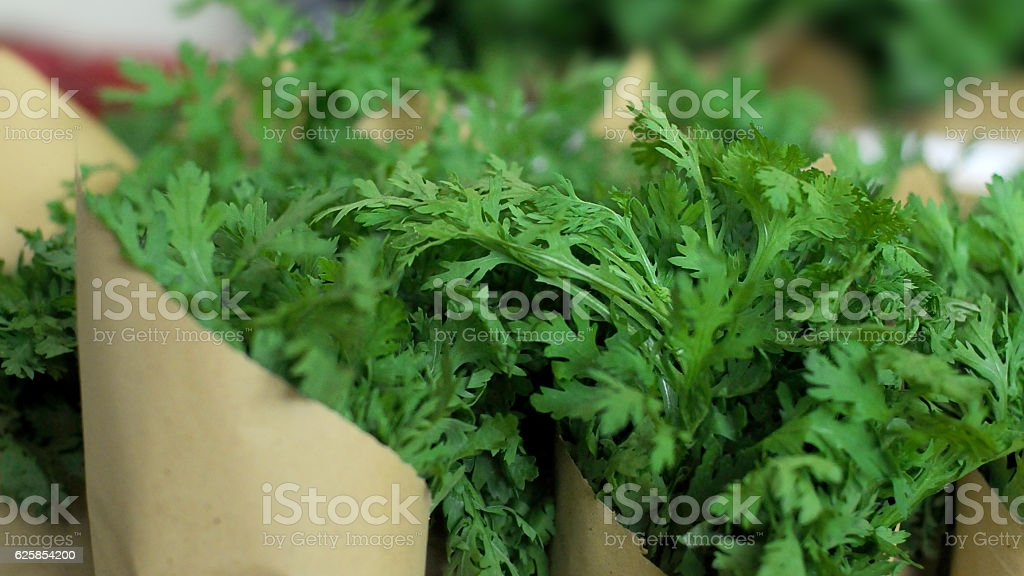 Packet of Garlard Chrysanthemum leafs stock photo