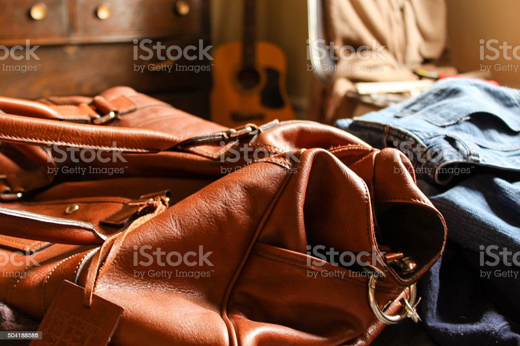 Packing a leather duffle stock photo