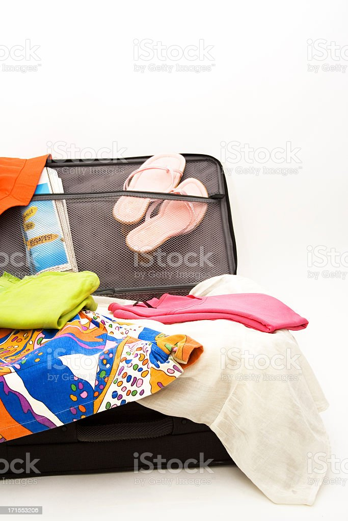 Open suitcase, packing for vacation
