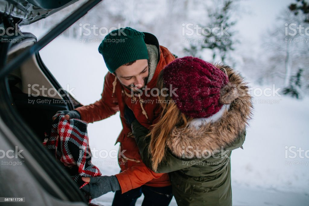 Packing for romantic winter getaway stock photo